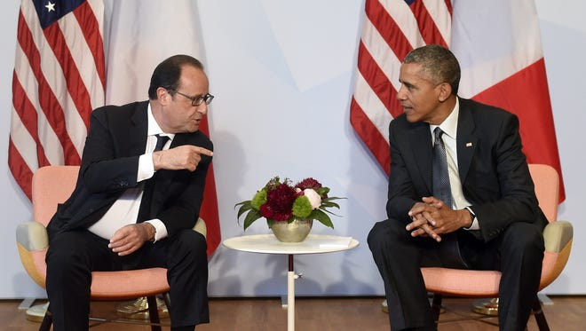 President Obama and French President Francois Hollande take part in a bilateral meeting on the sidelines of the G7 Summit at the Schloss Elmau castle resort near Garmisch-Partenkirchen, in southern Germany on June 8, 2015.