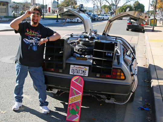 Lenny Hochteil poses with the 1981 DeLorean he had fitted with a plutonium reactor, lightning rod, and the flex capacitor.