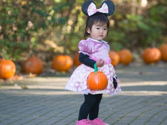 18 month old Shieri Suzuki dresses as Minnie Mouse at the Zoo Boo, Binder Park Zoo.
