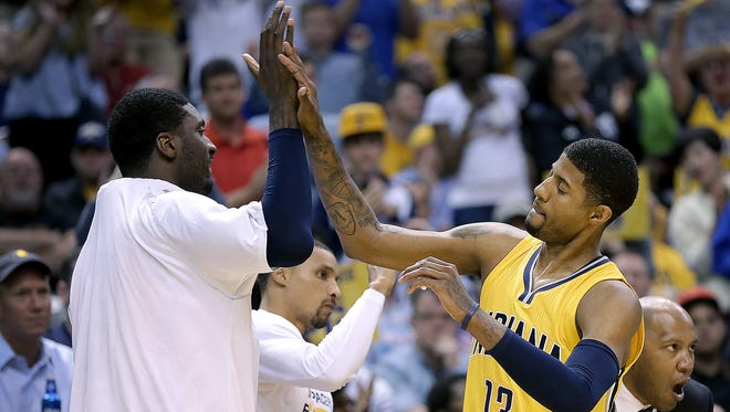 Indiana Pacers forward Paul George (13) high-fives Roy Hibbert as he checks out of the game in the second half of their game Sunday, April 5, 2015, evening at Bankers Life Fieldhouse. The Pacers defeated the Heat 112-89.