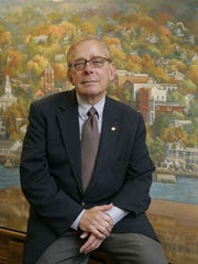 Former Nyack Mayor John Shields is pictured in front of a mural in Village Hall in 2007.