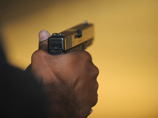 A cadet holds his pistol during target practice at