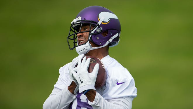 Minnesota Vikings wide receiver Michael Floyd (14) catches a pass at Winter Park in Eden Prairie, MN.