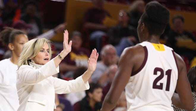 ASU's head coach Charli Tuner Thorne high-fives her team during the second half against Idaho at Wells Fargo Arena on December 18, 2017 in Tempe, Ariz.