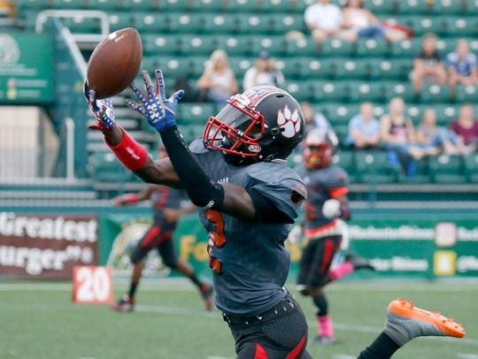 Incomplete pass for Wilson's Rickey Gamble against Batavia in the first quarter at Capelli Sport Stadium
