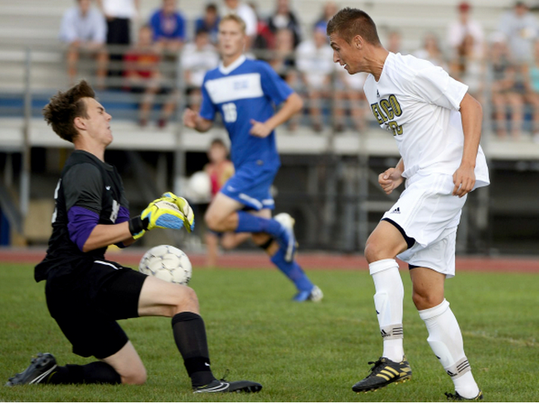 Cedar Crest goalkeeper John Krall blocks a shot by Elco's Blaine Troutman during the 2014 Hoffman-Ritter Cup at Elco High School last fall. (Jeremy Long -- Lebanon Daily News)