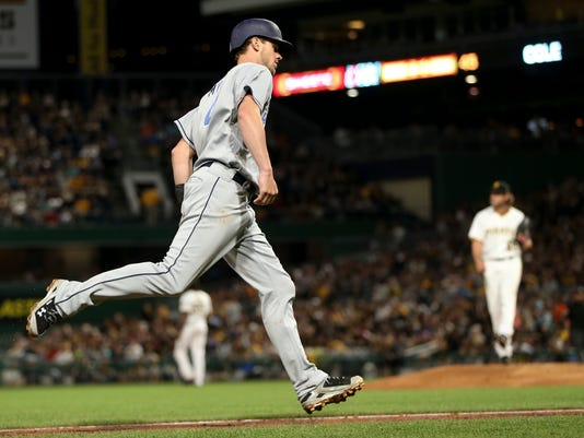 San Diego Padres' Wil Myers, left, rounds third base after hitting a two-run home run off Pittsburgh Pirates starting pitcher Gerrit Cole, right, during the fifth inning of a baseball game, Saturday, Aug. 5, 2017, in Pittsburgh. (AP Photo/Keith Srakocic)