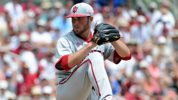 Joey DeNato (pictured above) struck out nine over eight innings in a 5-2 Indiana victory over Iowa on Wednesday, starting the Hoosiers off with a win in the Big Ten tournament.