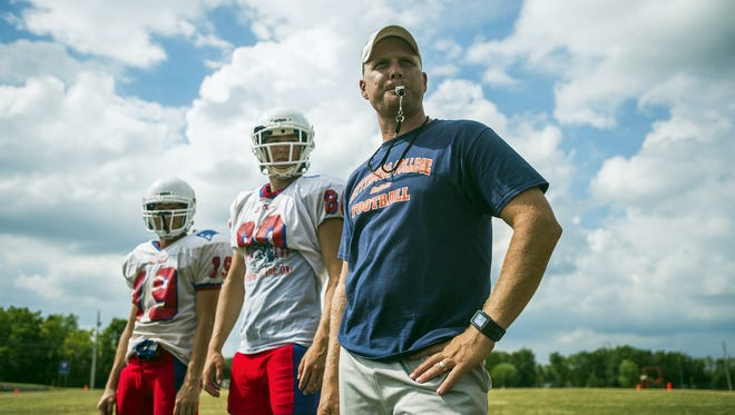 New Oxford head coach Jason Warner works with his team Wednesday Aug. 19, 2015 during practice at New Oxford High School.   Shane Dunlap - GameTimePA.com