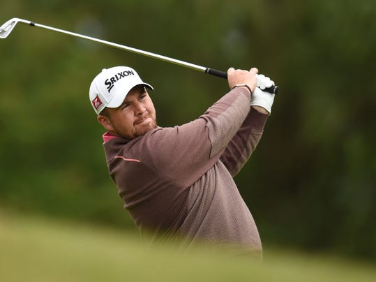 Ireland's Shane Lowry  plays a shot during day three of the BMW PGA Championships at the Wentworth Club, Virginia Water England Saturday May 24, 2014.(AP Photo/Adam Davy/PA) UNITED KINGDOM OUT