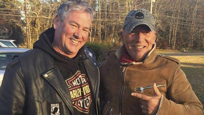 Dan Barkalow, left, and Bruce Springsteen poses for a photo in Wall Township. Barkalow and a group from the Freehold American Legion was riding after a Veterans Day event Friday when they pulled over to help a stranded motorcyclist who turned out to be The Boss.