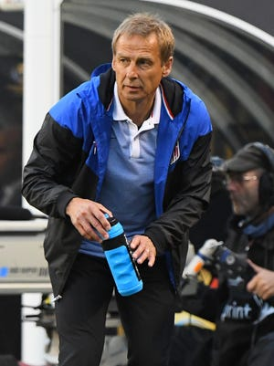 United States team manager Jurgen Klinsmann gets a drink in the first half during the group play stage of the 2016 Copa America Centenario. at Soldier Field.