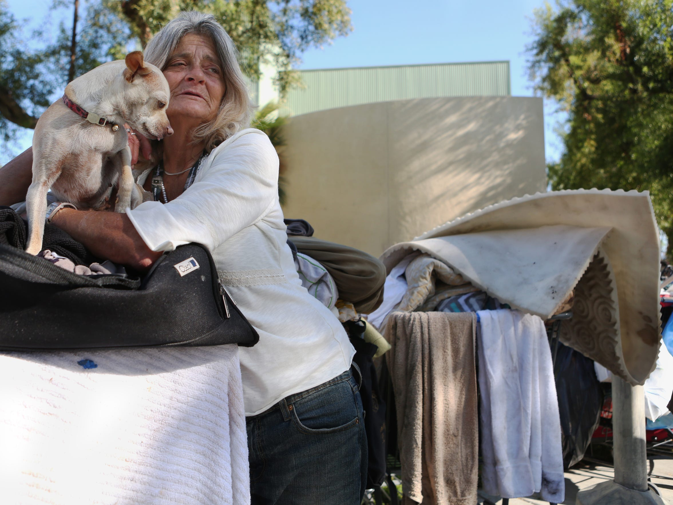 Karen Boatner talks about being homeless at Sunrise Park on Wednesday, April 13, 2016 in Palm Springs, Calif.