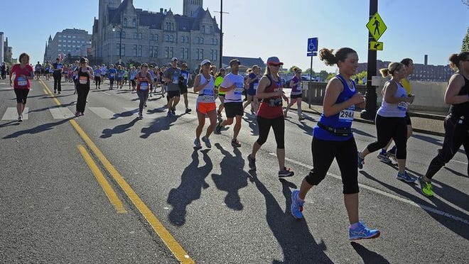 Runners make their way through the course during the Country Music Marathon Saturday April 26, 2014, in Nashville, TN.