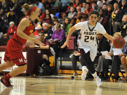 Maryland's Kristen Confroy defends Maryland Eastern Shore's Moengarora Subritzky as she drives to the basket against on Sunday, Dec. 20 at the William P. Hytche Athletic Center.