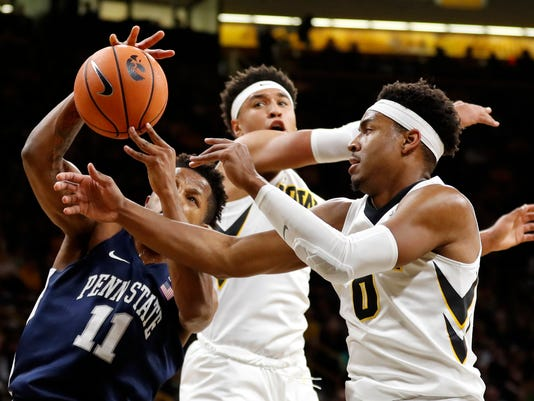 Penn State forward Lamar Stevens (11) fights for a rebound with Iowa's Ahmad Wagner, right, and Cordell Pemsl, rear, during the first half of an NCAA college basketball game, Saturday, Dec. 2, 2017, in Iowa City, Iowa. (AP Photo/Charlie Neibergall)