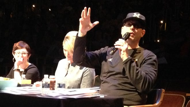 Jim Harbaugh, Sarah Harbaugh, center, and Fresh Start Clubhouse director Summer Berman, left, judge the Mock Rock talent show Tuesday, Feb. 21, 2017 in Ann Arbor. The show raised money for mental illness awareness.
