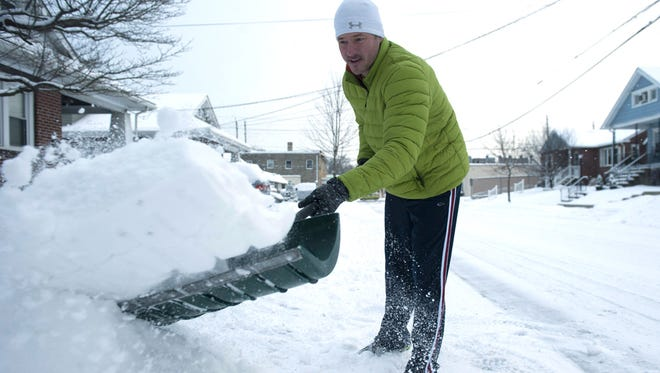 Kevin Scully of Haddon Heights clears snow from his driveway. Tuesday, February 17, 2015.