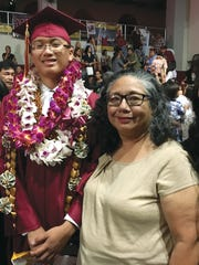 Jason Su Cruz, Father Duenas Memorial School Class of 2018, was awarded a four-year scholarship at Boston University's innovative Societal Engineer program in Aerospace and Nanotechnology. Jason, is pictured with godparent, Barbara Lizama Jose. He is the son of John R. Duenas Cruz and Qiao Qing Su Cruz.