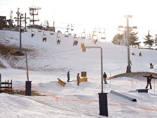 Skiers and snowboarders take advantage of the man made