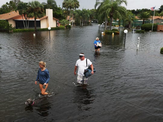 Royal Woods residents evacuate their homes on Monday 8/28/2017. Heavy rains have caused significant flooding throughout the area including the Island Park neighborhood.