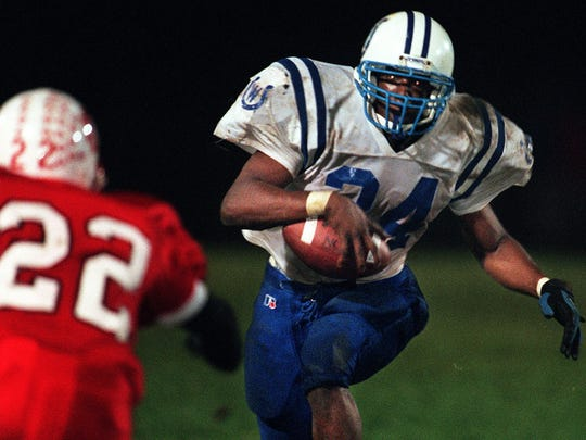 Wyoming High running back Richard Hall runs up field