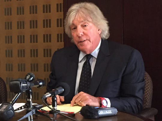 Attorney Geoffrey Fieger plays a recorded conversation during a press conference at his office in Southfield, Tuesday, August 22, 2017.