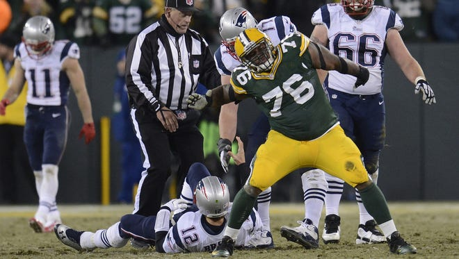 Green Bay Packers defensive tackle Mike Daniels (76) reacts after sacking New England Patriots quarterback Tom Brady (12) late in the fourth quarter during Sunday's game at Lambeau Field. Evan Siegle/Press-Gazette Media
