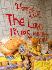 Bread and rolls are stored in a staging area at the Salvation Army before being packaged up for distribution.