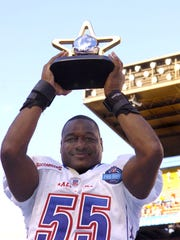 Tampa Bay Buccaneers linebacker Derrick Brooks holds up the most valuable player trophy  February 12, 2006 at the Pro Bowl  at Aloha Stadium in Honolulu, Hawaii. (Photo by Al Messerschmidt/Getty Images)