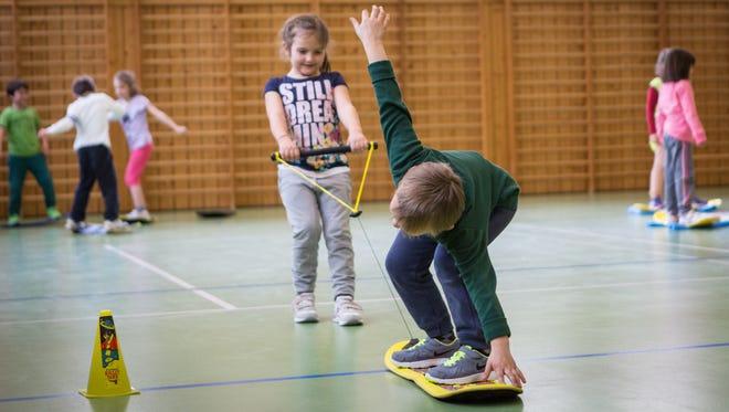 Burton Snowboard's Riglet School program demonstrates pulling teamwork at a school in Seiser Alm, Italy.