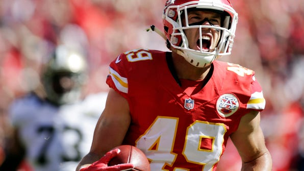 FILE - In this Oct. 23, 2016, file photo, Kansas City Chiefs defensive back Daniel Sorensen (49) celebrates after returning an interception for a touchdown during the first half of an NFL football game against the New Orleans Saints in Kansas City, Mo. The Chiefs and Sorensen agreed to a $16 million, four-year contract that keeps the restricted free agent off the market, a person with knowledge of the deal told The Associated Press, Saturday March 11, 2017. (AP Photo/Colin E. Braley, File)