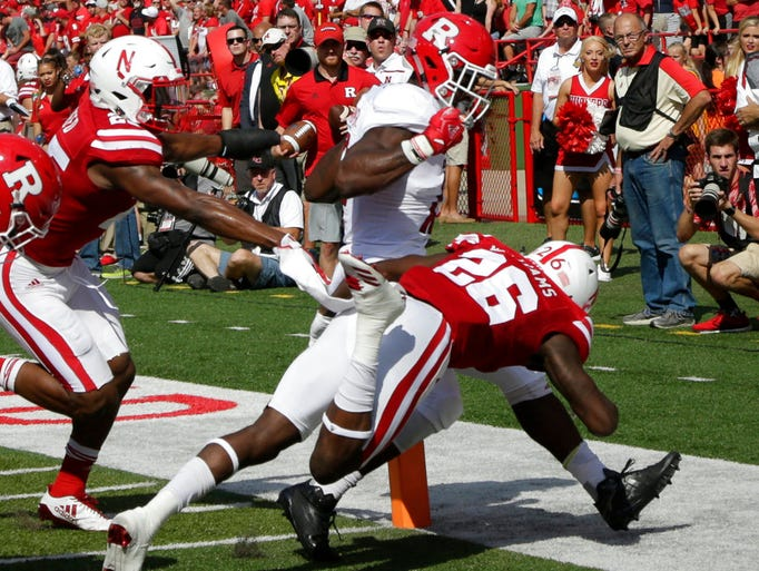 Rutgers running back Gus Edwards, center, crosses into