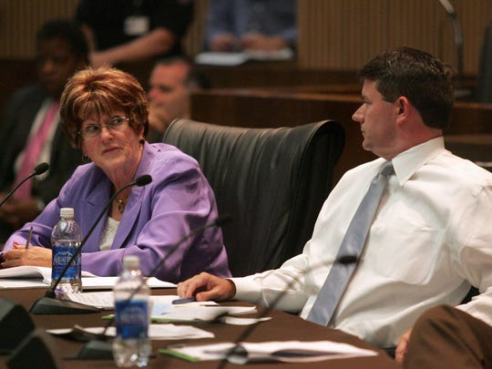 Phoenix Councilwoman Thelda Williams, left, discusses an initiative with Finance, Efficiency and Innovation subcommittee chairman Bill Gates that proposes outsourcing more municipal service jobs at a meeting Wednesday, June 23, 2010, at City Hall in Phoenix.