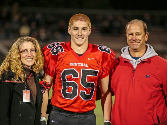 Timothy Piazza, center, with his parents Evelyn Piazza,