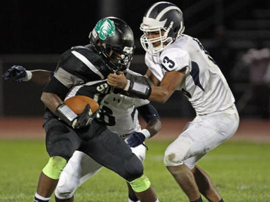 German Pimentel (right) makes a tackle during a 2015 game against South Plainfield