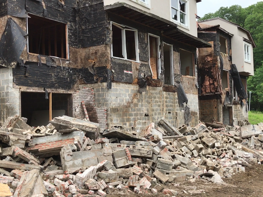 Demolition of the long abandoned Lakeside Manor townhouse building in Wanaque, N.J. took place on May 30, 2017 after the owner walked away from the project 15 years ago.