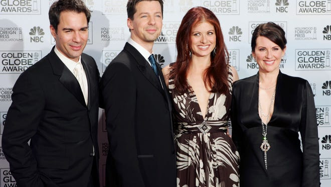 """In this Jan. 16, 2006 file photo, cast members from the comedy series """"Will & Grace,"""" from left, Eric McCormack, Sean Hayes, Debra Messing and Megan Mullally, pose backstage after making an award presentation at the 63rd Annual Golden Globe Awards in Beverly Hills, Calif.  The stars of """"Will & Grace"""" are back together in a video that delivers punchlines and a political message: vote for Hillary Clinton."""