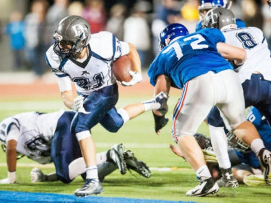 Dallastown's Addison Quinones (21) breaks through the Spring Grove defensive line during a YAIAA football game Friday. Quinones rushed for 139 yards on 19 carries. Dallastown won, 20-3. (Jeff Lautenberger -- For GameTimePA.com)
