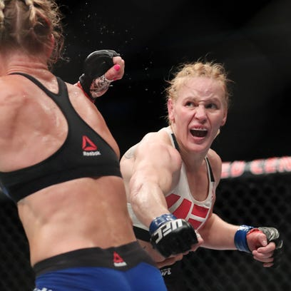 July 23, 2016; Chicago, IL, USA; Holly Holm (red gloves) competes against Valentina Shevchenko (blue gloves) in their women's bantamweight bout during UFC Fight Night at United Center. Mandatory Credit: Kamil Krzaczynski-USA TODAY Sports