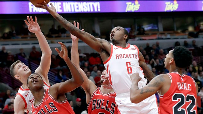 Houston Rockets forward Gary Clark, second from right, battles for a rebound with forward/center Isaiah Hartenstein (55) against Chicago Bulls forward/center Cristiano Felicia, second from left, guard Zach LaVine (8) and guard Cameron Payne (22) during the first half of an NBA basketball game Saturday, Nov. 3, 2018, in Chicago. (AP Photo/Nam Y. Huh)