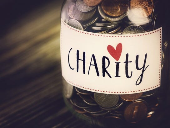 """Jar of coins labeled """"charity"""""""