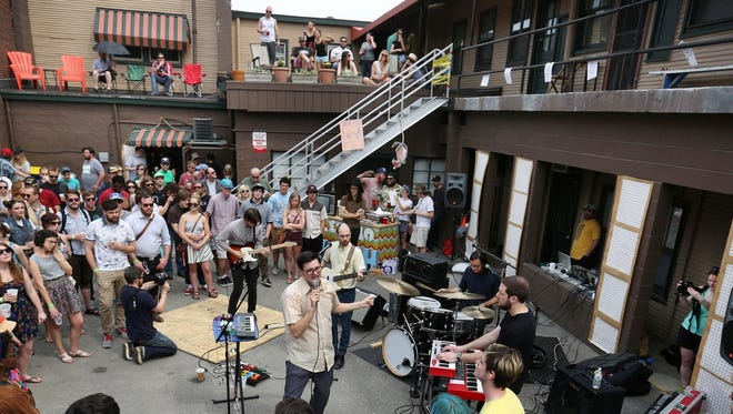 Music fans gather around Mike Adams At His Honest Weight during 2015 Record Store Day festivities at Luna Music.