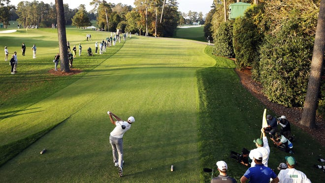 Dustin Johnson tees off on No. 18 during the third round of the Masters Tournament at Augusta National Golf Club. Johnson shot a bogey-free 65 and leads the tournament by four shots.