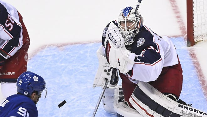 Joonas Korpisalo, making one of his 33 saves against the Maple Leafs' John Tavares in the Blue Jackets' win Sunday, is the only seasoned goalie available to the team with Elvis Merzlikins out indefinitely.