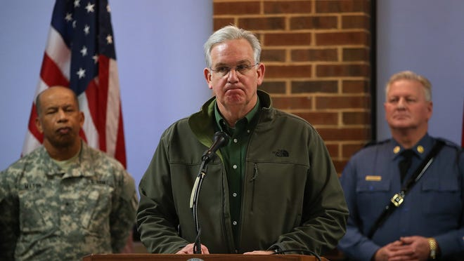 Missouri Gov. Jay Nixon pauses as he speaks during a news conference at the University of Missouri on Nov. 25, 2014 in St. Louis, Missouri.