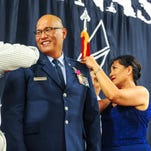 "Guam Air National Guard's Col. Johnny Lizama sports a smile as Gov. Eddie Calvo, left, and his wife, Doris ""Dee"" Lizama pins stars on his shoulders during a promotion ceremony at the Guam National Guard Readiness Center in Barrigada on Wednesday, July 29. Lizama became the first Chamorro airman to be promoted, and federally recognized, to the rank of brigadier general in the Guam Air National Guard and the U.S. Air Force, according to a Guard release."