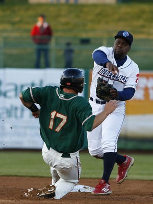 Korea Dunbar of the Greensboro Grasshoppers is out as BlueClaws second baseman Josh Tobias makes the throw to first base to complete the double play at First Energy Park in Lakewood on Thursday