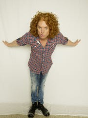 Comedian Carrot Top is known for his rock 'n' roll