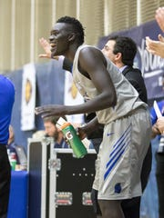 UWF senior guard Moter Deng celebrates with teammates in game last year against  Shorter University .